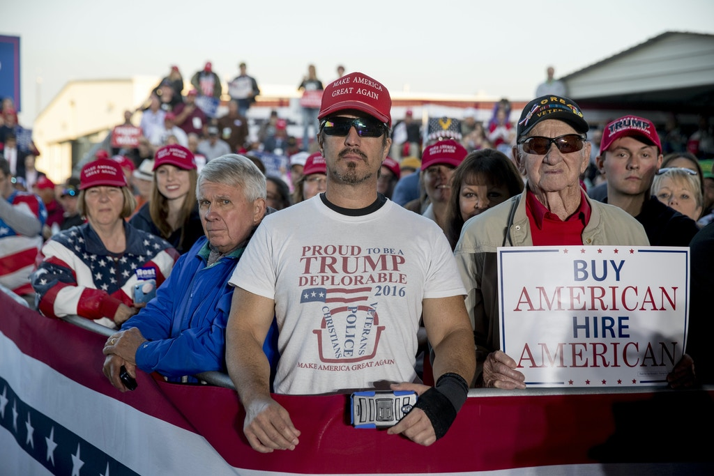 "A member of the audience wears a shirt that reads ""Proud to Be A Trump Deplorable"" as President Donald Trump speaks at a rally at Southern Illinois Airport in Murphysboro, Ill., Saturday, Oct. 27, 2018. (AP Photo/Andrew Harnik)"