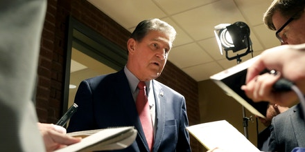 FILE- In this Nov. 1, 2018, file photo, Sen. Joe Manchin speaks to reporters after a debate with Patrick Morrisey in Morgantown, W.Va. Manchin goes after a second full term in the Senate on Tuesday, Nov. 6, against comparative political newcomer Patrick Morrisey, the two-term Republican state attorney general hoping to ride plenty of attention from Trump in recent months to victory. (AP Photo/Raymond Thompson, File)