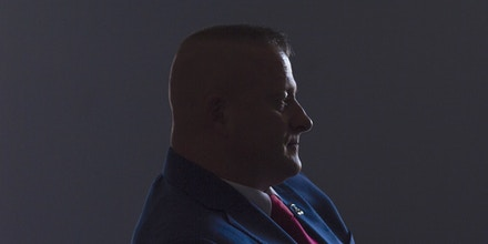 Richard Ojeda, who is running as a Democrat for West Virginia House District 3, is silhouetted by a nearby window as he works on his speeches with his communications director Madalin Sammons at his campaign headquarters in Chapmanville, W.Va., on Election Day, November 6, 2018. (Craig Hudson/The Charleston Gazette-Mail via AP)