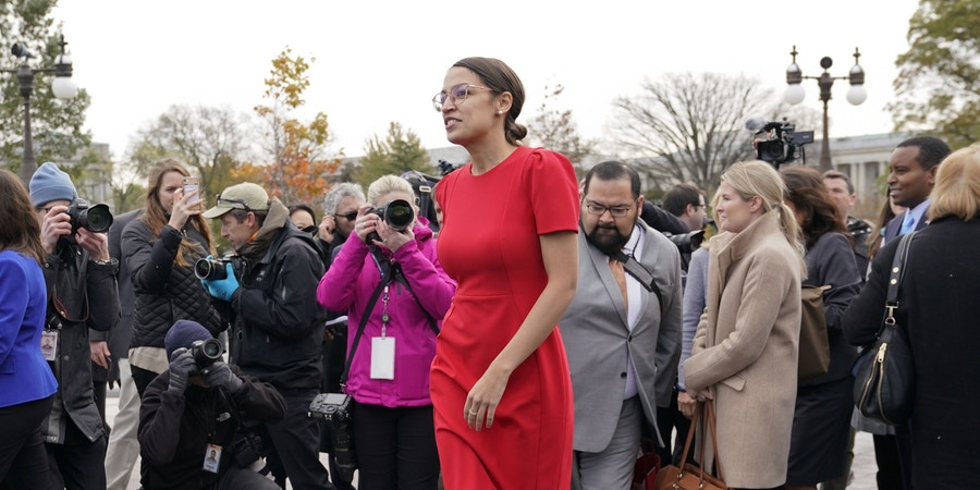 Rep.-elect Alexandria Ocasio-Cortez, D-NY., walks away after a group photo with other members of the freshman class of Congress on Capitol Hill in Washington, Wednesday, Nov. 14, 2018, in Washington. (AP Photo/Pablo Martinez Monsivais)