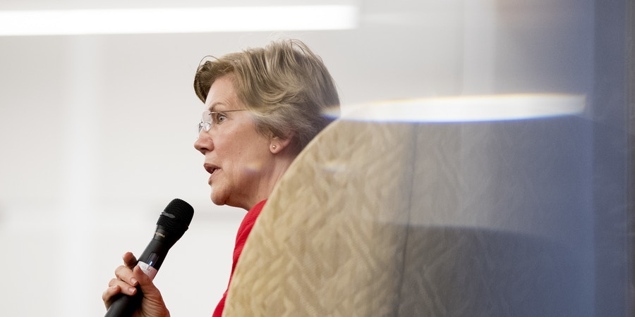 Sen. Elizabeth Warren, D-Mass., answers a question from the audience at the American University Washington College of Law in Washington, Thursday, Nov. 29, 2018, after delivering a speech on her foreign policy vision for the country. (AP Photo/Andrew Harnik)