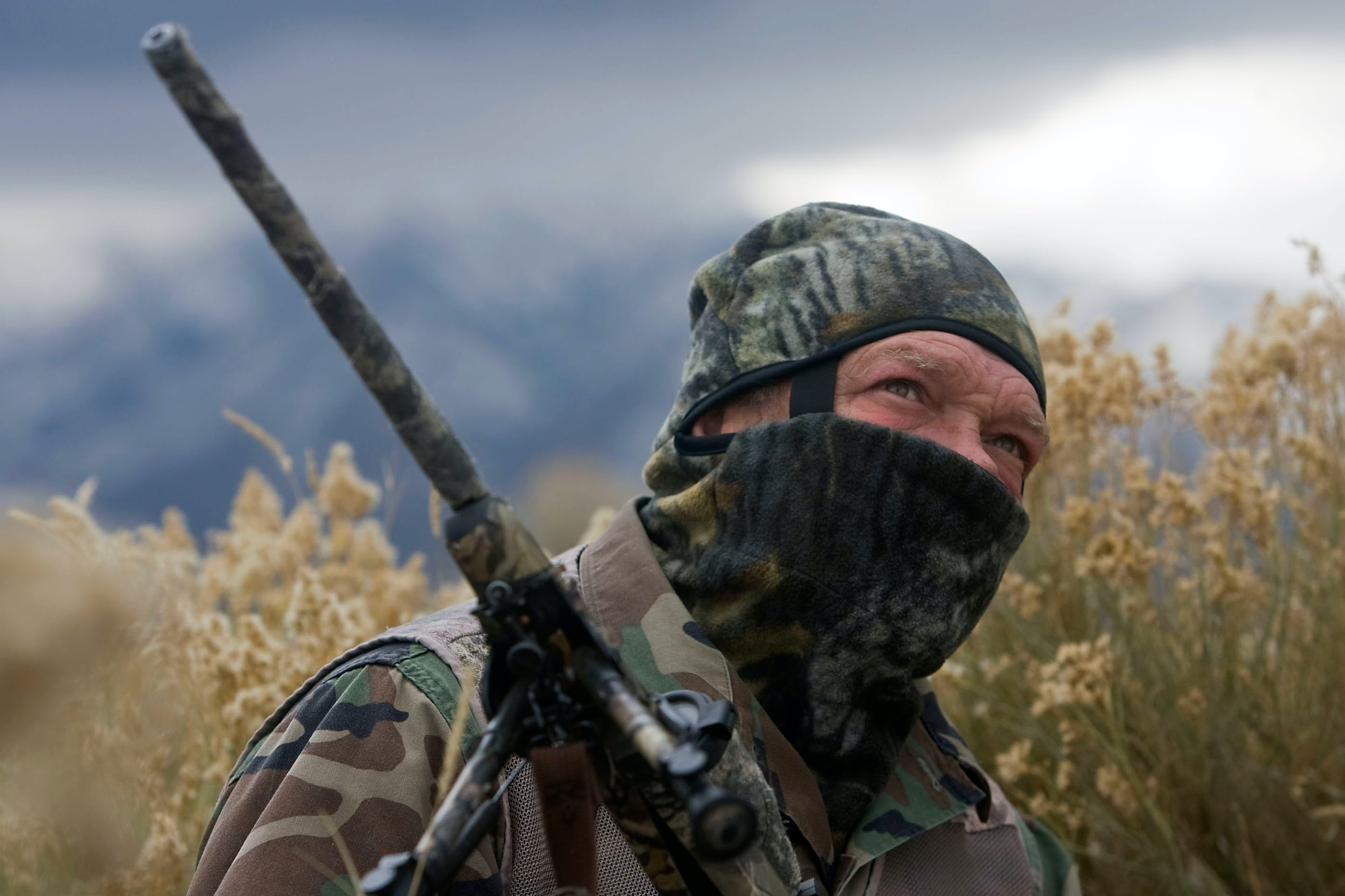In this Nov. 30, 2011 photo, William Keebler appears in camouflage in Vernon, Utah. Keebler, a Utah militia group leader with ties to Nevada rancher Cliven Bundy,  has been arrested and charged with attempting to blow up a rural, federally-owned cabin in Arizona, federal authorities said Thursday, June 23, 2016. (Al Hartmann /The Salt Lake Tribune via AP)
