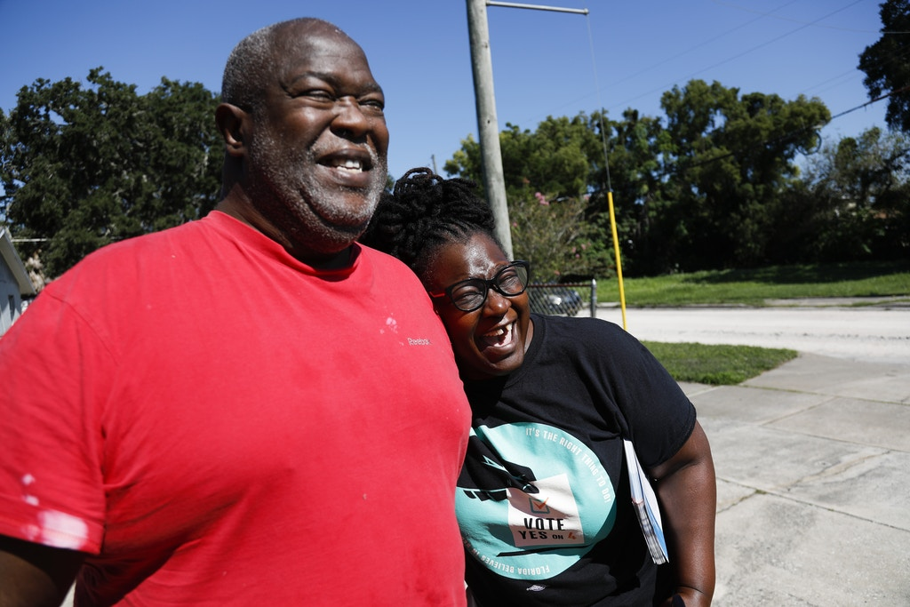 Stefanie Anglin hugs Willie McDonald after he told her that he already voted in Orlando on Monday, October 29, 2018. In the upcoming election on November 6, Floridians will have the opportunity to vote on Amendment 4, which would give people who have been convicted of a felony the restored right to vote. Credit: Eve Edelheit for The Intercept