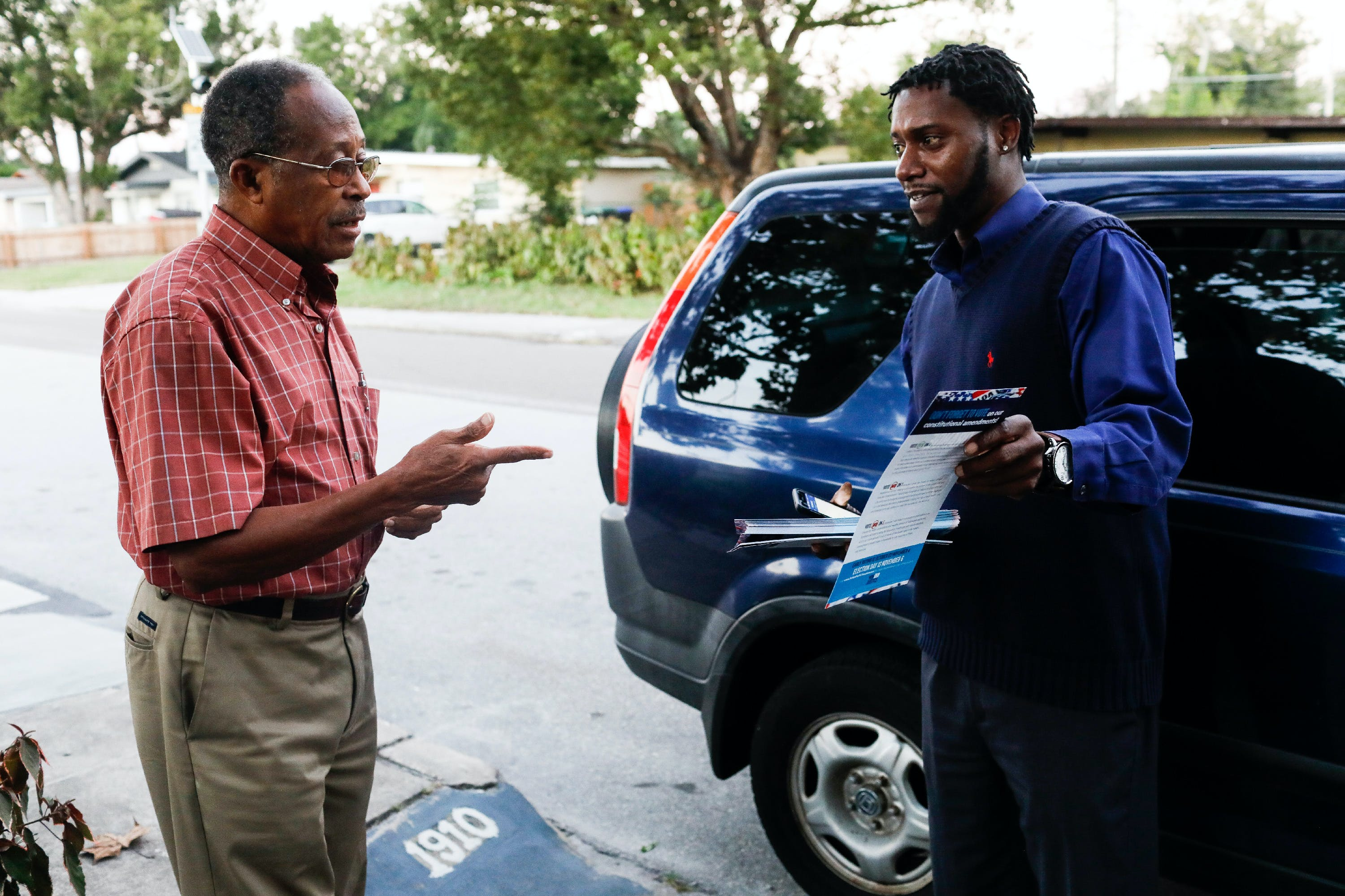 Travis Hailes talks to Mony Dorce about voting while canvassing in Orlando on Monday, October 29, 2018. In the upcoming election on November 6, Floridians will have the opportunity to vote on Amendment 4, which would give people who have been convicted of a felony the restored right to vote. Credit: Eve Edelheit for The Intercept
