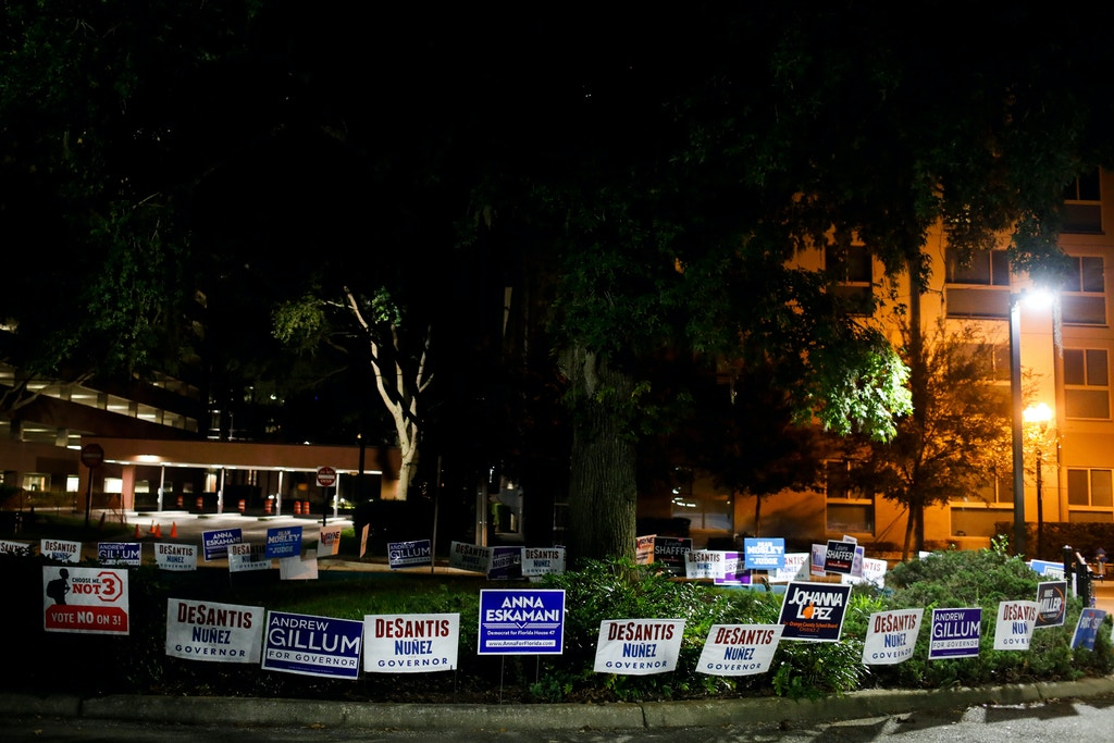 Political signs outside of Marks Street Senior Recreation in Orlando on Monday, October 29, 2018. In the upcoming election on November 6, Floridians will have the opportunity to vote on Amendment 4, which would give people who have been convicted of a felony the restored right to vote. Credit: Eve Edelheit for The Intercept