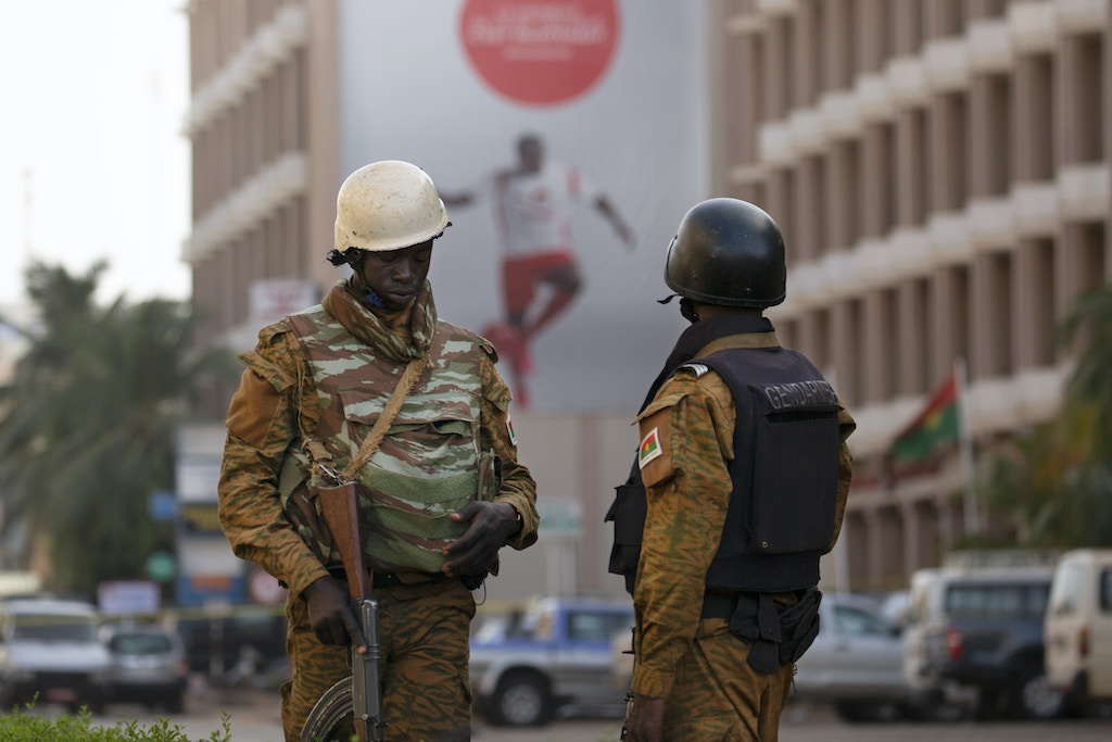 Security forces stand guard after an Al Qaeda attack that killed 30 people in a restaurant and hotel in Ouagadougou, Burkina Faso, January 16, 2016. Joe Penney