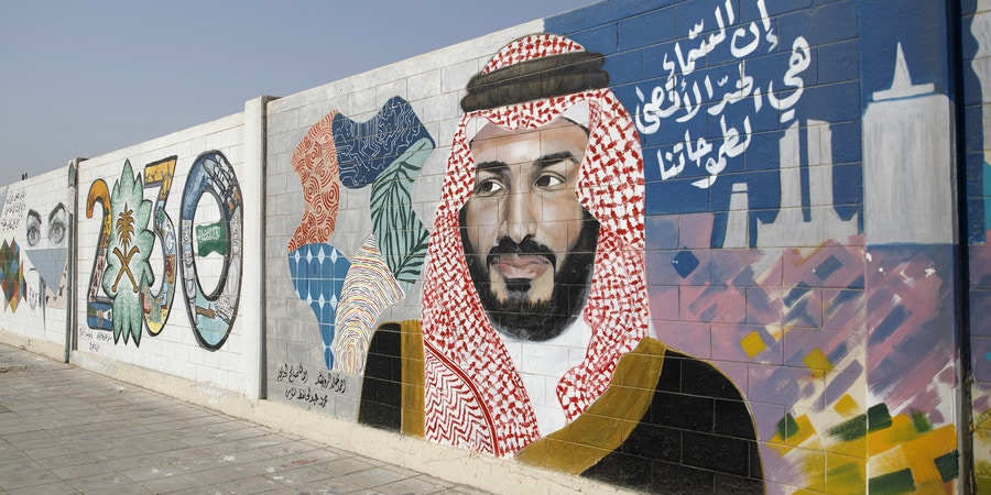 A wall mural displays the '2030 Vision' logo and Saudi Arabia's Crown Prince Mohammed bin Salman in Dhahran, Saudi Arabia, on Thursday, Oct. 4, 2018. Saudi Arabia's Crown Prince Mohammed said the central elements of his Vision 2030 plan, including the $100 billion Saudi Aramco sale and the effort to boost non-oil revenue, remain on course. Photographer: Simon Dawson/Bloomberg via Getty Images