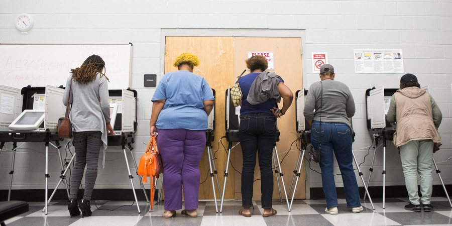 ATLANTA, GA - OCTOBER 18: Voters cast ballots during the early voting period at C.T. Martin Natatorium and Recreation Center on October 18, 2018 in Atlanta, Georgia.  Early voting started in Georgia on October 15th.  Georgia's Gubernatorial election is a close race between Democratic candidate Stacey Abrams and Republican candidate Brian Kemp.  (Photo by Jessica McGowan/Getty Images)
