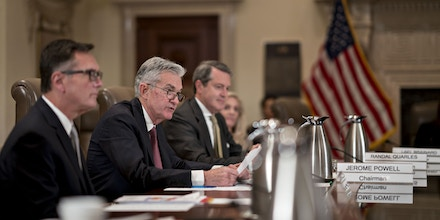 Jerome Powell, chairman of the U.S. Federal Reserve, center, speaks as Richard Clarida, vice chairman of the Federal Reserve, left, and Randal Quarles, vice chairman of supervision at the Federal Reserve, listen during a Federal Reserve Board meeting in Washington, D.C., U.S., on Wednesday, Oct. 31, 2018. The Federal Reserve and other agencies -- responding to legislation that's meant to soften rules for smaller lenders -- are proposing that a series of complex capital demands only apply to Wall Street megabanks. Photographer: Andrew Harrer/Bloomberg via Getty Images