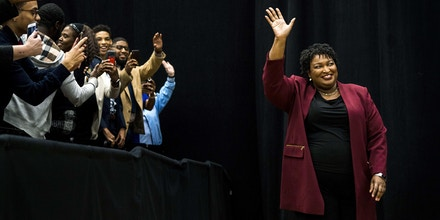 ATLANTA, GEORGIA  - Democratic nominee for Georgia Governor Stacey Abrams enters the arena before she introduces former President Barack Obama before a crowd of thousands at Morehouse College as he campaigns for  in Atlanta, Georgia Friday November 2, 2018. (Photo by Melina Mara/The Washington Post via Getty Images)