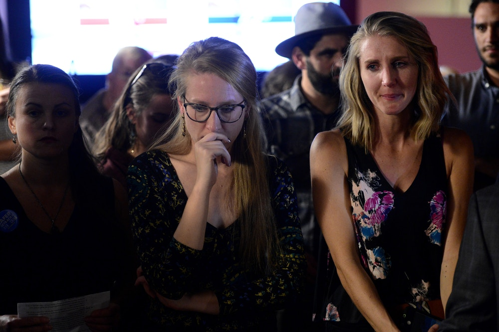 DENVER, COLORADO - NOVEMBER 6: Ann Lee Foster, center, and Suzanne Spiegel, right, proponents of Proposition 112, center, hold back the tears as they concede defeat during the watch party for Proposition 112 at Big Trouble Restaurant inside Zeppelin Station on November 6, 2018 in Denver, Colorado.  Colorado voters defeated their measure that would have created larger setbacks for oil and gas. (Photo by Helen H. Richardson/The Denver Post via Getty Images)