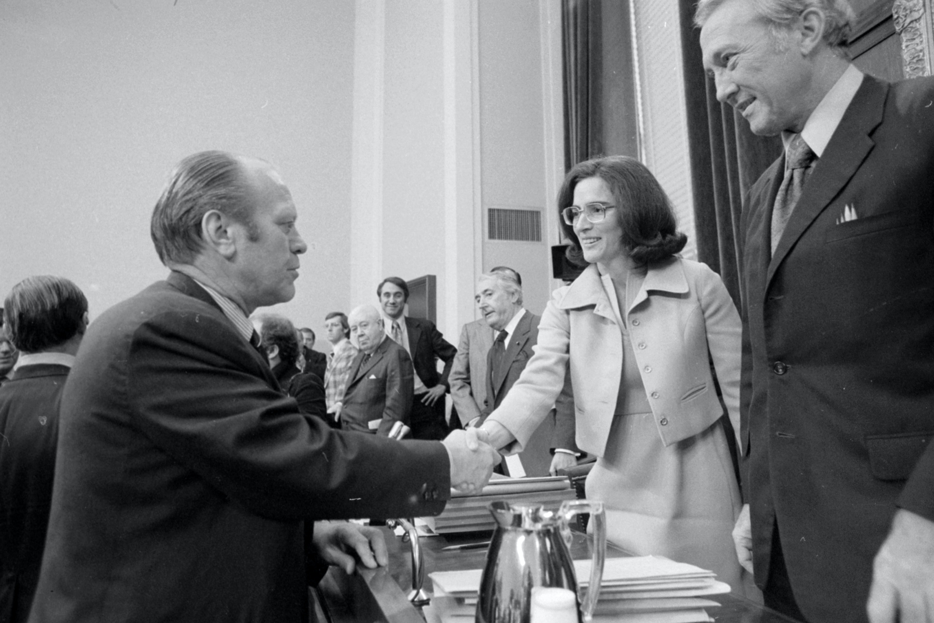 (Original Caption) 10/17/1974-Washington, DC- President Ford shakes hands with Representative Elizabeth Holtzman (D-NY), after Ford completed his testimony to the House Judiciary subcommittee on his reasons for granting a pardon to former President M. Nixon. Representative Holtzman is the subcommittee's most outspoken critic of the pardon.