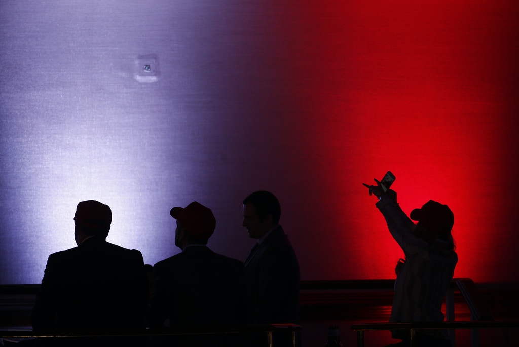 The silhouettes of attendees are seen during an election night party for 2016 Republican Presidential Nominee Donald Trump at the Hilton Midtown hotel in New York, U.S., on Tuesday, Nov. 8, 2016. Fifty-one percent of voters nationally were bothered a lot by Trump's treatment of women, while Democrat Hillary Clinton's use of private e-mail while secretary of state was troubling to 44 percent, according to preliminary exit polling as voting neared a close in some states. Photographer: Andrew Harrer/Bloomberg via Getty Images
