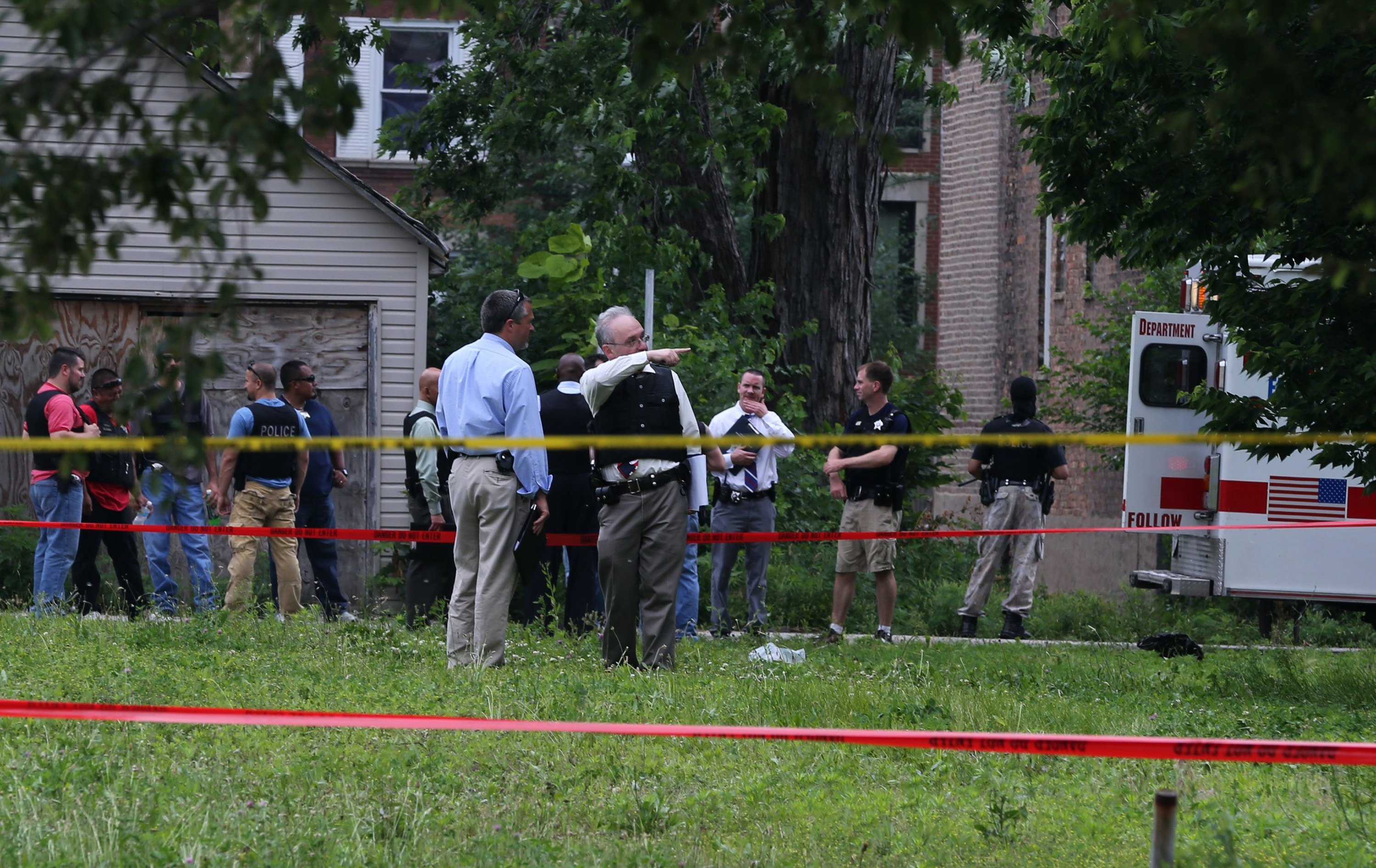 Officers investigate the scene of the police-involved shooting of Christian Green, 17, in the 5600 block of South State State on July 4, 2013 in Chicago. Officer Robert Gonzalez said Green turned and pointed a gun at him during a short chase through the Washington Park neighborhood. (Antonio Perez/Chicago Tribune/TNS via Getty Images)