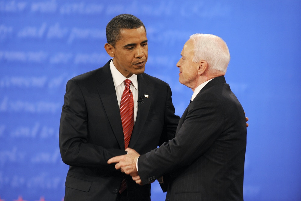 US Democratic presidential candidate Barack Obama (L) and Republican John McCain shake hands at the end of the final presidential debate at Hofstra University in Hempstead, New York, on October 15, 2008.         AFP PHOTO/Emmanuel Dunand (Photo credit should read EMMANUEL DUNAND/AFP/Getty Images)