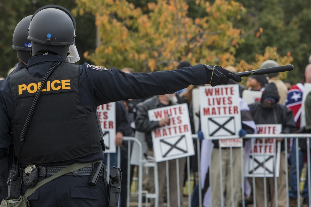 "SHELBYVILLE, TN - OCTOBER 28: Police stand between protestors during a White Lives Matter rally on October 28, 2017 in Shelbyville, Tennessee. Tennessee Gov. Bill Haslam said state and local law enforcement officials would be out ""in full force"" for the two white nationalist rallies. The event billed as a White Lives Matter rally is hosted by Nationalist Front, which is a coalition of several white supremacist organizations. (Photo by Joe Buglewicz/Getty Images)"