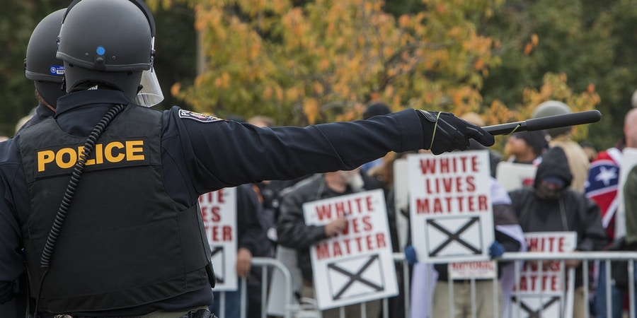 SHELBYVILLE, TN - OCTOBER 28: Police stand between protestors during a White Lives Matter rally on October 28, 2017 in Shelbyville, Tennessee. Tennessee Gov. Bill Haslam said state and local law enforcement officials would be out