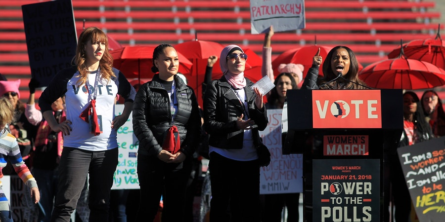 LAS VEGAS, NV - JANUARY 21:  Women's March co-founders (L-R) Bob Bland, Carmen Perez and Linda Sarsour listen as fellow co-founder Tamika Mallory speaks during the Women's March