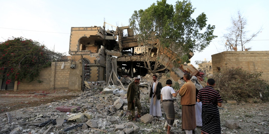 Yemenis inspect the damage as they stand in the rubble of a destroyed house in the aftermath of a reported air strike by the Saudi-led coalition in a neighbourhood in the Yemeni capital Sanaa on June 6, 2018. - According to media reports, at least nine Yemenis, including two women, were injured. (Photo by MOHAMMED HUWAIS / AFP)        (Photo credit should read MOHAMMED HUWAIS/AFP/Getty Images)