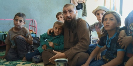 Abu Osama and his children at his home in Syria.