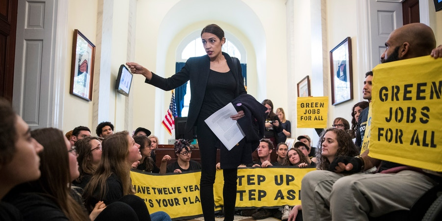 Alexandria Ocasio-Cortez, congresswoman-elect from New York, speaks to activists with the Sunrise Movement protesting in the offices of House Minority Leader Nancy Pelosi (D-Calif.) on Capitol Hill, in Washington, Nov. 13, 2018. (Sarah Silbiger/The New York Times)