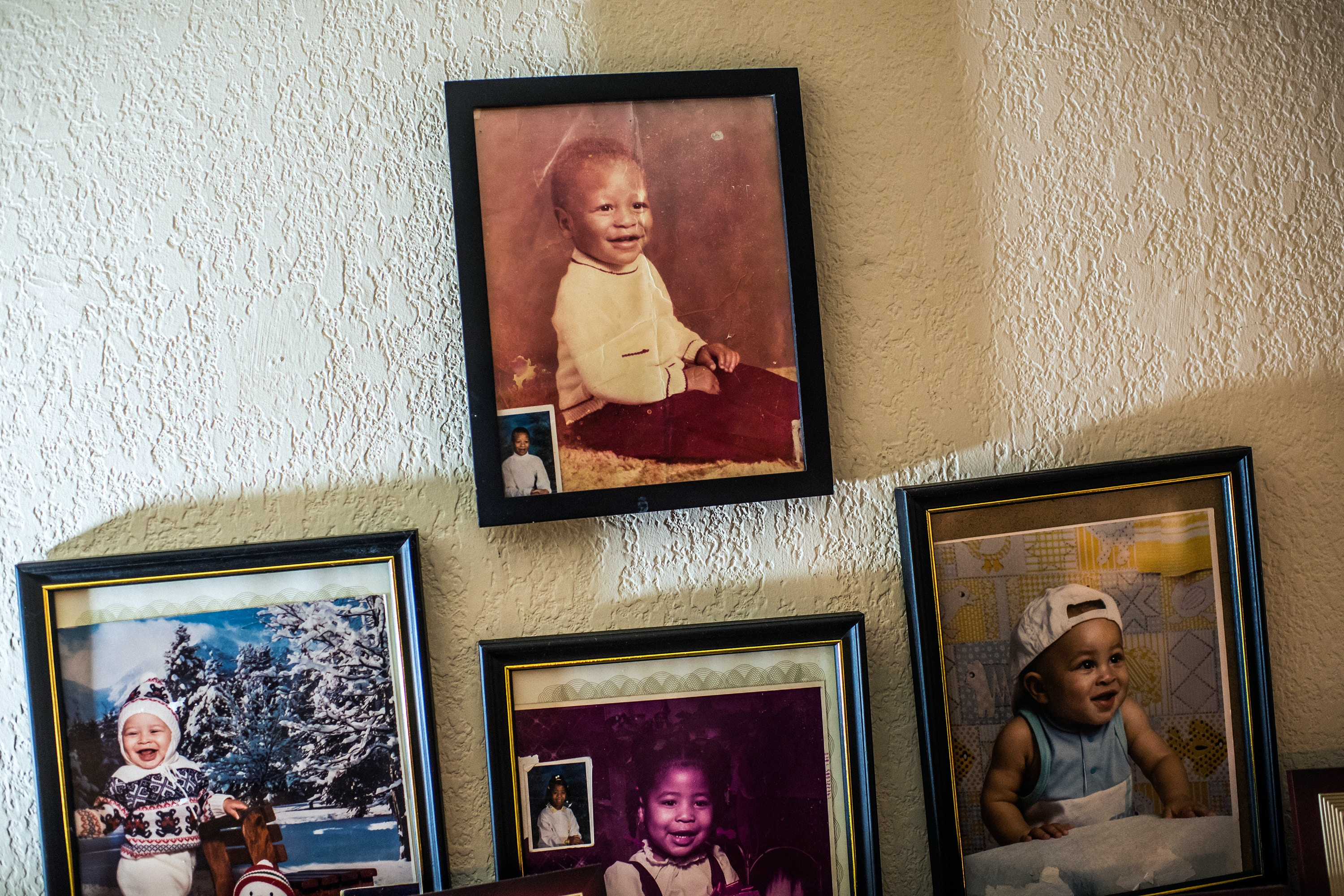 Old family photos at Dave and Dinah Ray's house in Sacramento. The top photo is of Devonia Inman.
