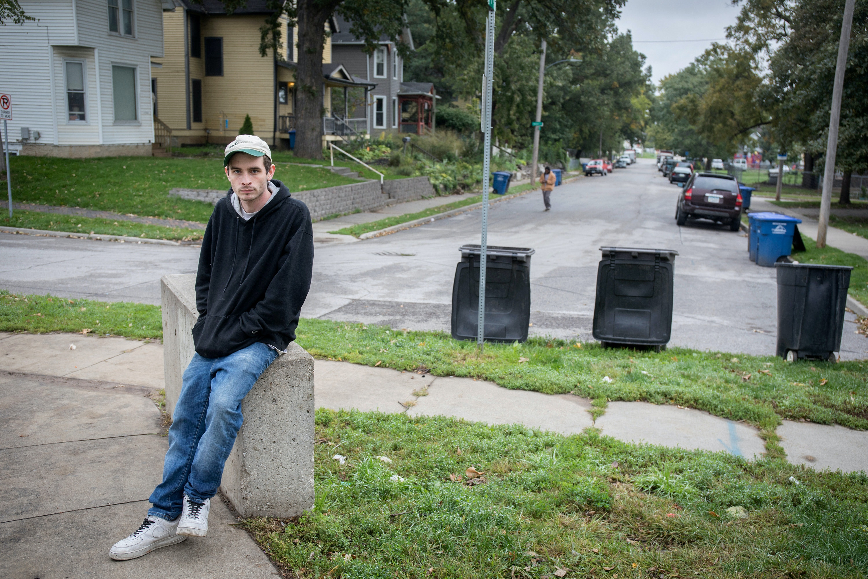 Jesse Horne stands in front of a house occupied by Catholic Workers on Oct. 5, 2018, in Des Moines, Iowa. He lived there but was kicked out of after being accused of being an infiltrator of the anti-Dakota Access pipeline movement. After being thrown out, Jess was homeless and often walked around the neighborhood near downton Des Moines, Iowa. (Rachel Mummey for The Intercept).