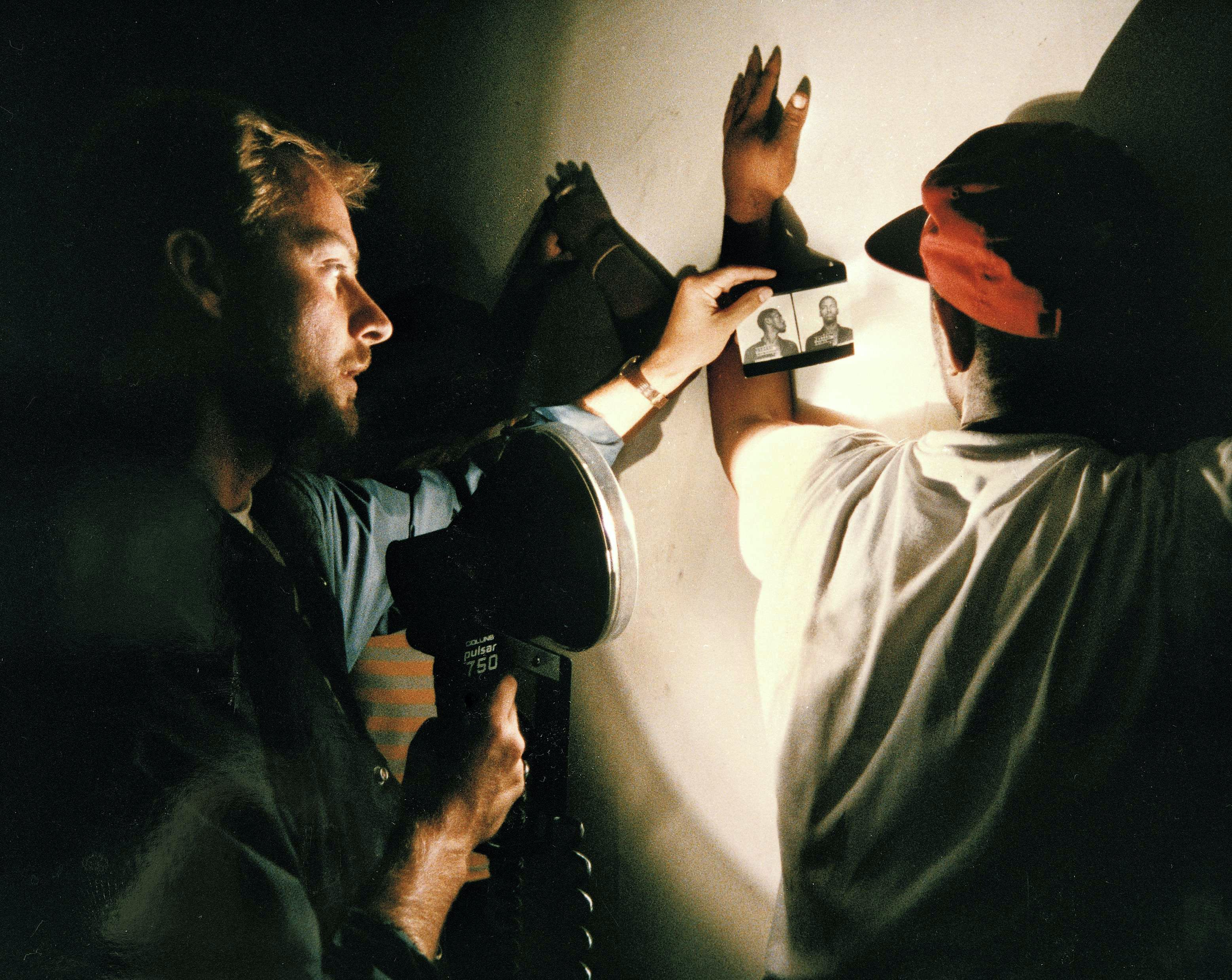A U.S. marshal, left, looking for a suspect, shows a mug shot to a man found allegedly using drugs in a crackhouse, according to police, in Washington, D.C., July 18, 1989. This scene, and many like it, were repeated many times during operation STOP: Street Terror Offender Program. Some 456 fugitives were arrested as a result of the eight-week anti-drug program, which is part of President George H.W. Bush's War on Drugs. (AP Photo/J. Scott Applewhite)