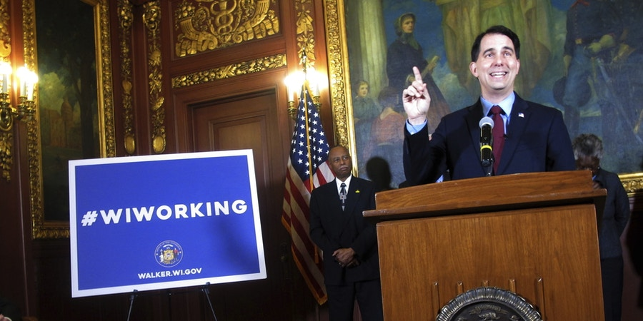 Gov. Scott Walker describes his proposal to reduce food stamp benefits for parents who do not work at least 80 hours a month or meet other requirements to get trained for a job and apply for work, Monday, Jan. 23, 2017, in Madison, Wis. (AP Photo/Scott Bauer)