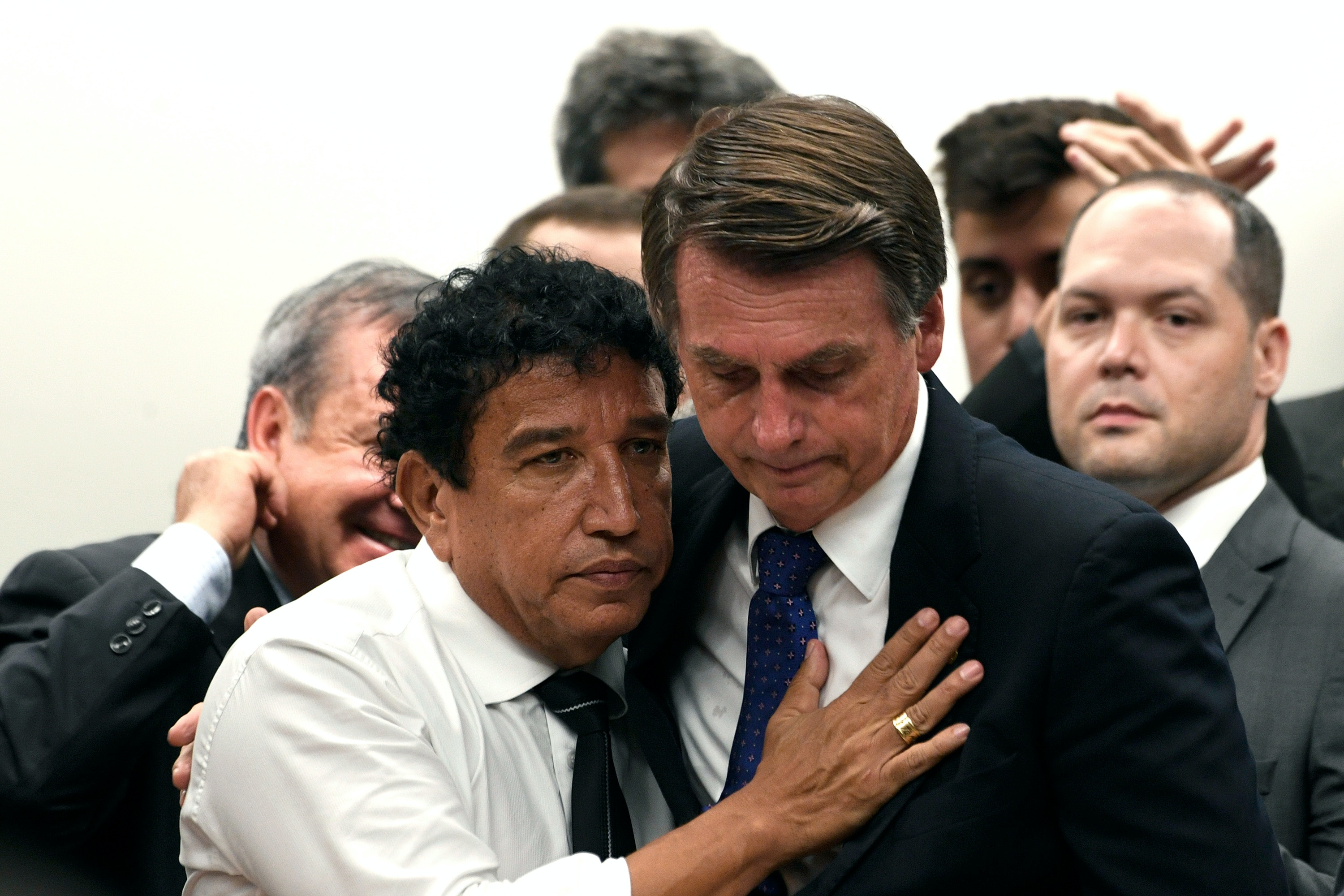 Jair Bolsonaro accompanied by Senator Magno Malta during a filming ceremony in the PSL party on Wednesday, March 7, held in the Chamber of Deputies Photo: Mateus Bonomi / AGIF - Brasilia - 07/03/2018 - Filiation of Jair Bolsonaro in PSL (via AP)
