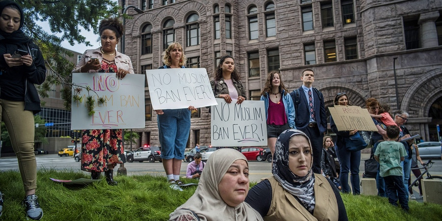 Protesters who started at the Federal Courthouse demonstrate in the street to show their opposition at the Supreme Court's decision to uphold the Trump administration's travel ban Tuesday, June 26, 2018, in Minneapolis. Muslim individuals and groups, as well as other religious and civil rights organizations, expressed outrage and disappointment at the U.S. Supreme Court's decision Tuesday to uphold President Donald Trump's ban on travel from several mostly Muslim countries. (Richard Tsong-Taatarii/Star Tribune via AP)