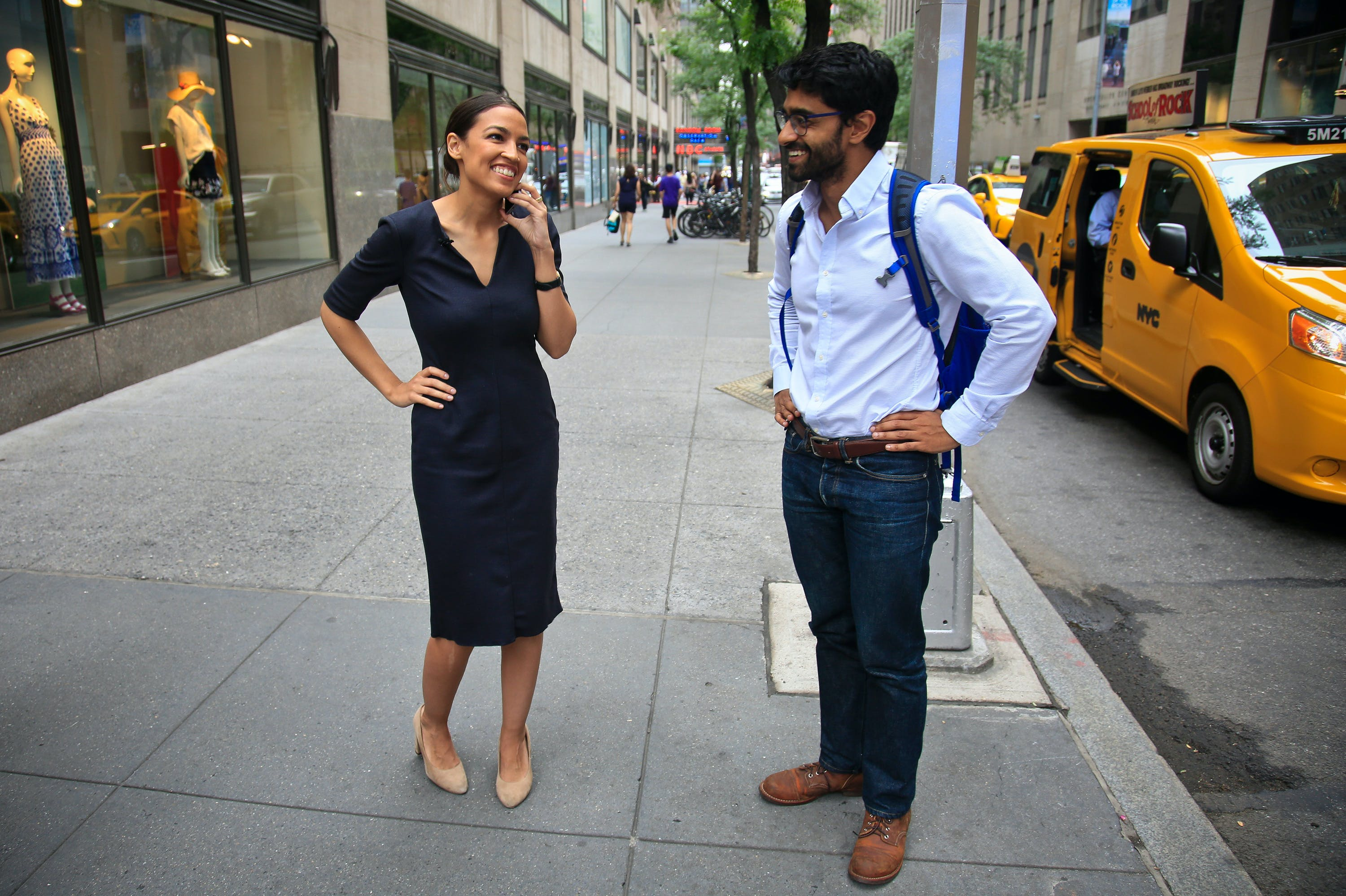 "Alexandria Ocasio-Cortez, left, the winner of the Democratic primary in New York's 14th Congressional District, speaks on a phone as Saikat Chakrabarti, her senior campaign adviser stands by, Wednesday, June 27, 2018, in New York. The 28-year-old political newcomer upset U.S. Rep. Joe Crowley, says she brings an ""urgency"" to the fight for working families.  (AP Photo/Bebeto Matthews)"