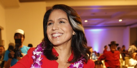 Rep. Tulsi Gabbard, D-Hawaii, greets supporters Tuesday, Nov. 6, 2018, in Honolulu. (AP Photo/Marco Garcia)