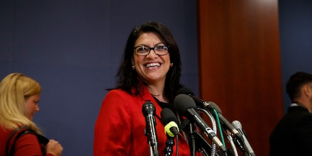 Rep.-elect Rashida Tlaib, D-Mich., pauses to speak to media as she walks from member-elect briefings and orientation on Capitol Hill in Washington, Thursday, Nov. 15, 2018. (AP Photo/Carolyn Kaster)