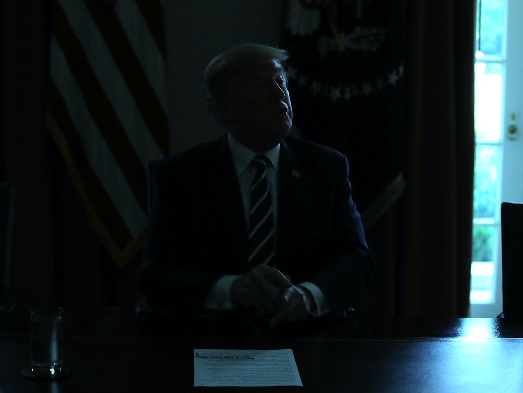 WASHINGTON, DC - JULY 17:  The lights temporarily go out in the Cabinet Room as U.S. President Donald Trump talks about his meeting with Russian President Vladimir Putin, during a meeting with House Republicans at the White House on July 17, 2018 in Washington, DC. Following a diplomatic summit in Helsinki, Trump faced harsh criticism after a press conference with Putin where he would not say whether he believed Russia meddled with the 2016 presidential election. (Photo by Mark Wilson/Getty Images)