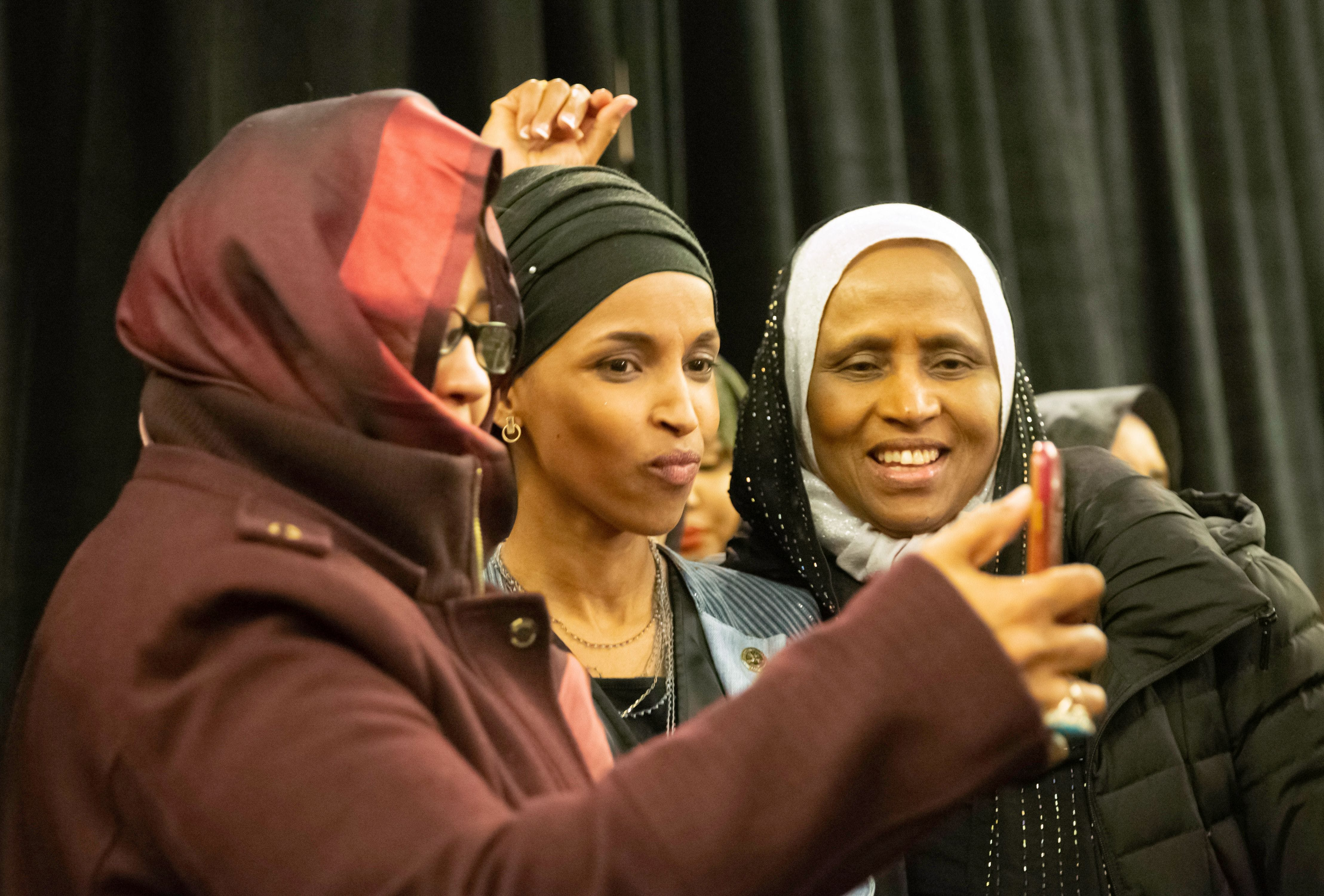 TOPSHOT - Ilhan Omar, newly elected to the U.S. House of Representatives on the Democratic ticket, celebrates with her supporters after her Congressional 5th District primary victory in Minneapolis, Minnesota on November 6, 2018. - US voters elected two Muslim women, both Democrats, to Congress on November 6, 2018, marking a historic first in a country where anti-Muslim rhetoric has been on the rise, American networks reported. Ilhan Omar, a Somali refugee, won a House seat in a heavily-Democratic district in the Midwestern state of Minnesota, where she will succeed Keith Ellison, himself the first Muslim elected to Congress. (Photo by Kerem Yucel / AFP)        (Photo credit should read KEREM YUCEL/AFP/Getty Images)
