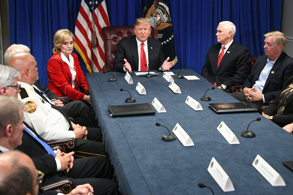 US President Donald Trump (C), Senator Cindy Hyde-Smith (L), Vice President Mike Pence (2ndfrom R) and Senator Lindsey Graham (R) participate in a roundtable on the FIRST STEP Act in Gulfport, Mississippi on November 26, 2018. (Photo by Jim WATSON / AFP)        (Photo credit should read JIM WATSON/AFP/Getty Images)