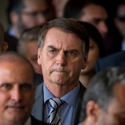 The president-elect of Brazil, Jair Bolsonaro (C), arrives for a press conference on the appointment of the ministers of Citizenship, Tourism and Regional Development at the headquarters of the transitional government in Brasilia on November 28, 2018. (Photo by Sergio LIMA / AFP)        (Photo credit should read SERGIO LIMA/AFP/Getty Images)