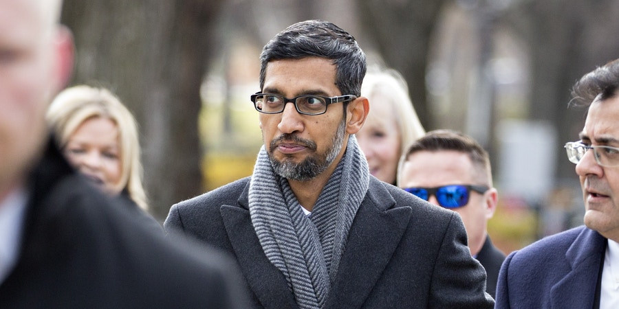 Sundar Pichai, chief executive officer of Google LLC, center, arrives to the White House for a meeting in Washington, D.C., U.S., on Thursday, Dec. 6, 2018. Technology industry leaders arrived to the White House for a summit to talk about emerging innovations like artificial intelligence while the effects of the administration's trade war with China loom in the background. Photographer: Andrew Harrer/Bloomberg via Getty Images
