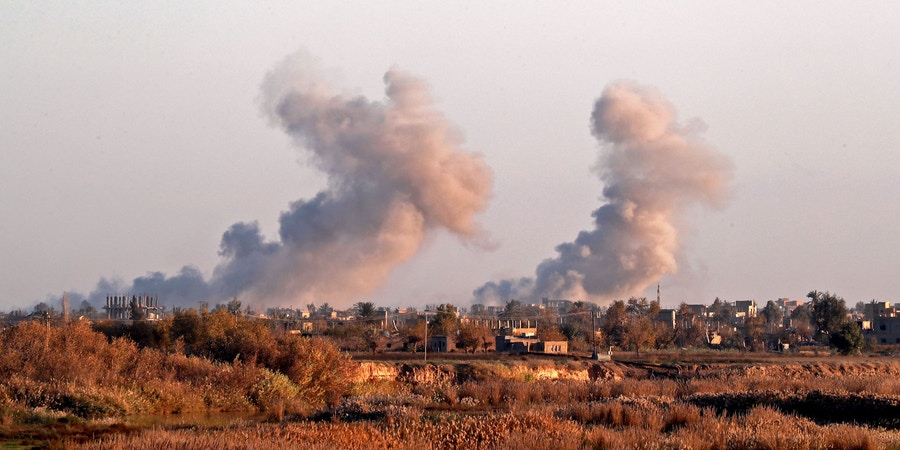 Smoke billows after bombings in the Deir Ezzor province, near Hajin, eastern Syria, on December 15, 2018. - Kurdish-led forces seized the Islamic State's main hub of Hajin on December 14, a milestone in a massive and costly US-backed operation to eradicate the jihadists from eastern Syria. The Syrian Democratic Forces secured Hajin, the largest settlement in what is the last pocket of territory controlled by IS, the Syrian Observatory for Human Rights said. (Photo by Delil SOULEIMAN / AFP)        (Photo credit should read DELIL SOULEIMAN/AFP/Getty Images)