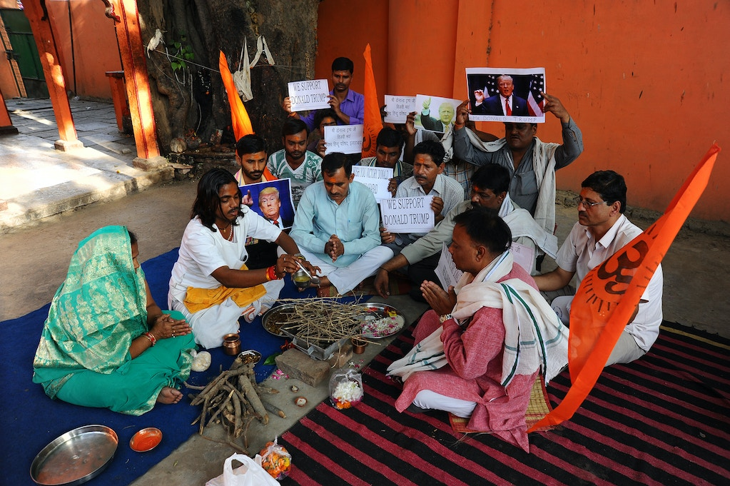 ALLAHABAD, UTTAR PRADESH, INDIA - 2016/05/18: Indian Hindu-nationalist Vishwa and hindu Parishad activists tossed offerings into a sacred fire and recited hymns in Sanskrit to pray for Trump's victory. (Photo by Prabhat Kumar Verma/Pacific Press/LightRocket via Getty Images)