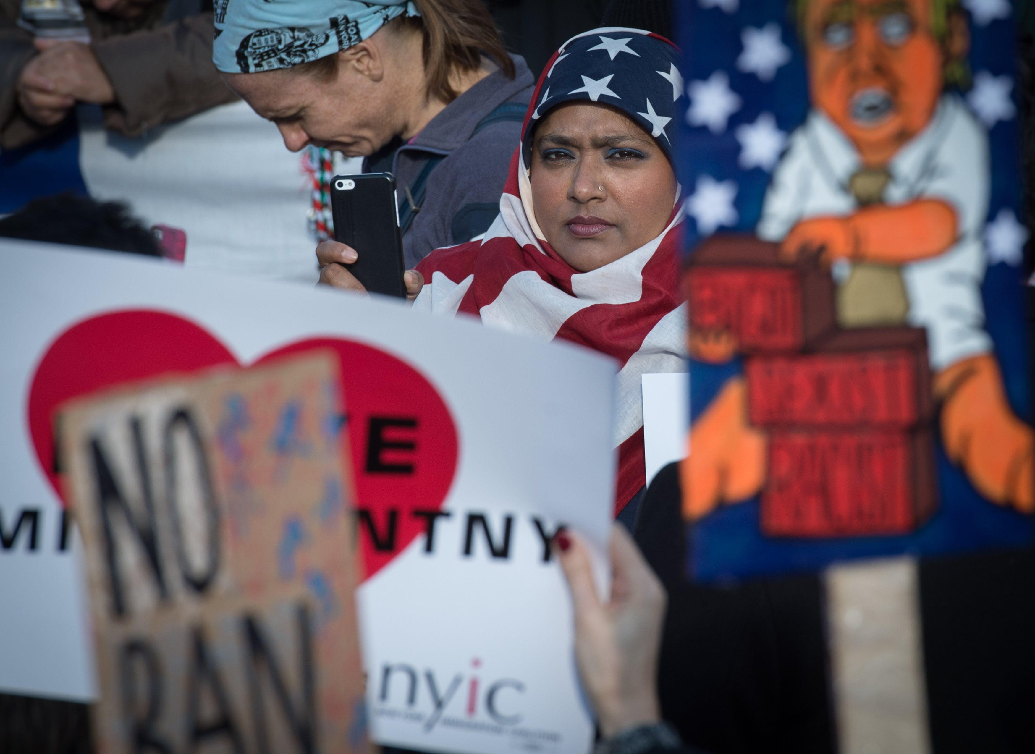 TOPSHOT - Protesters gather in Battery Park and march to the offices of Customs and Border Patrol in Manhattan to protest President Trump's Executive order imposing controls on travelers from Iran, Iraq, Libya, Somalia, Sudan, Syria and Yemen, January 29, 2017 in New York. / AFP / Bryan R. Smith        (Photo credit should read BRYAN R. SMITH/AFP/Getty Images)