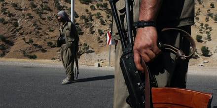 A member of the Kurdistan Workers' Party (PKK) carries an automatic rifle on a road in the Qandil Mountains, the PKK headquarters in northern Iraq, on June 22, 2018. - Hundreds of Iraqi Kurds marched Friday to protest Turkish strikes against the Kurdistan Workers' Party (PKK) after Turkey's President Recep Tayyip Erdogan said Ankara would press an operation against its bases. (Photo by SAFIN HAMED / AFP)        (Photo credit should read SAFIN HAMED/AFP/Getty Images)
