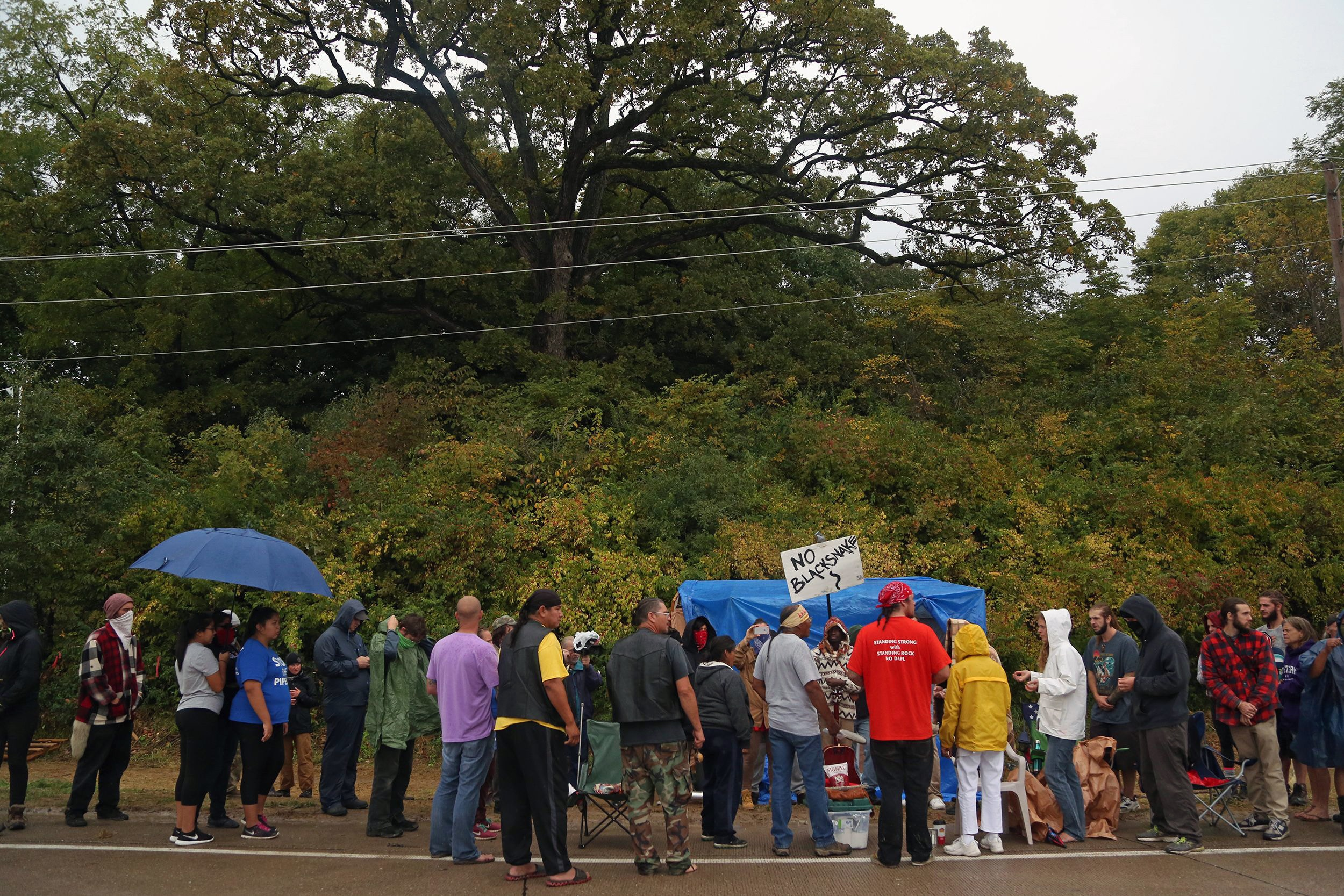 Oct. 6, 2016; Keokuk, IA, USA; Protesters gather at the Mississippi Stand Camp, at the entrance to the work area where a route for the Dakota Access Pipeline was being bored under the Mississippi River. A group of people from the Standing Rock protests joined the campers today. Mandatory Credit: Kelsey Kremer/The Register via USA TODAY NETWORK