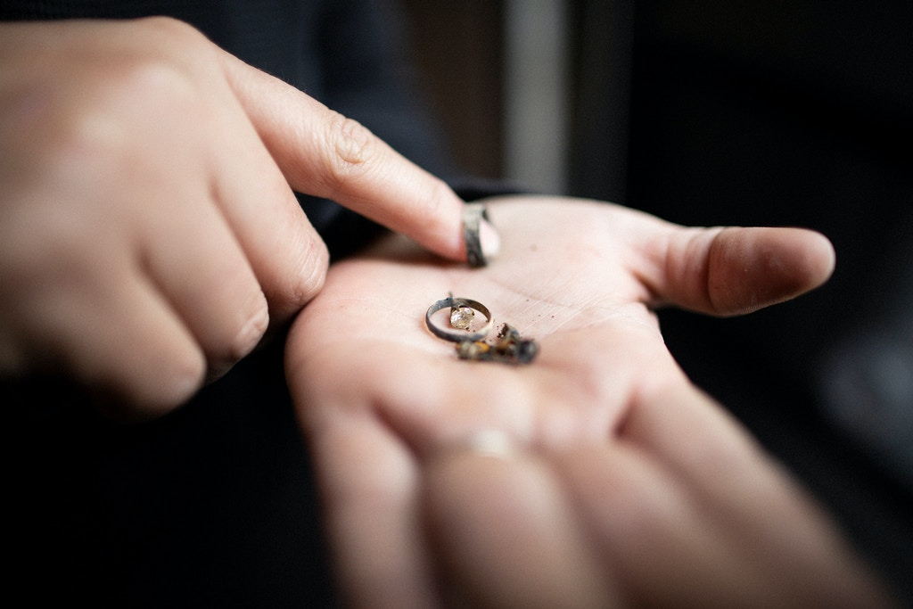 Michelle's Teixeira showing jewelry she pulled from the rubble of her home that burned in the Camp Fire in Paradise. The diamond earring was her grandmothers. She had her wedding ring made from the other earring and has plans on making this earring into a ring for her 14 year old daughter, Chico, California, December 21st, 2018.
