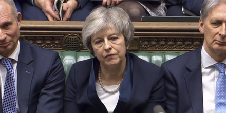 Brexit. Prime Minister Theresa May listens to Labour leader Jeremy Corbyn speaking after losing a vote on her Brexit deal in the House of Commons, London. Picture date: Tuesday January 15, 2019. See PA story POLITICS Brexit. Photo credit should read: House of Commons/PA Wire URN:40645107 (Press Association via AP Images)