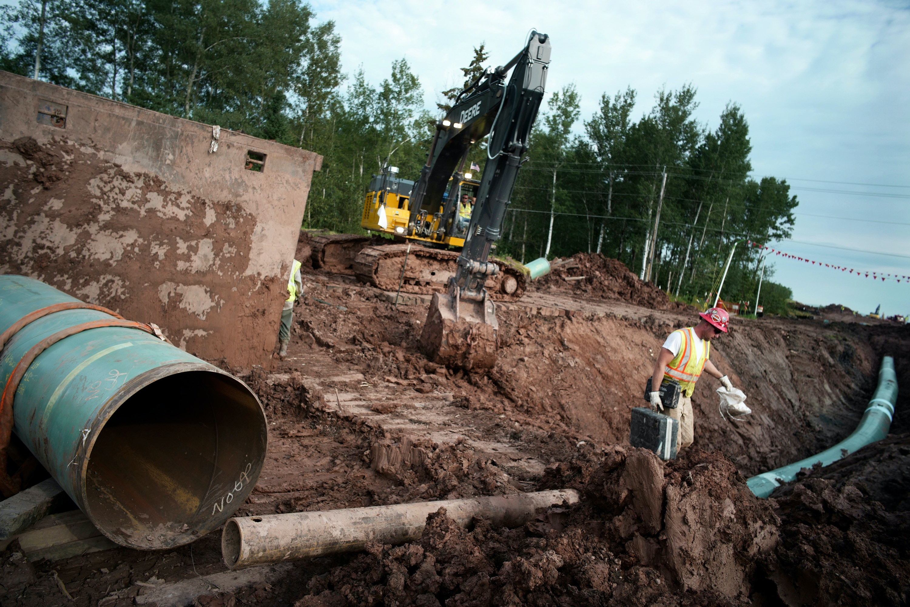 In an Aug. 21, 2017 photo, workers make sure that each section of the replacement Line 3 that is joined passes muster. Enbridge already has started building the 14-mile stretch of Line 3 from the Minnesota line to its terminal in Superior, Wis. In filings with the Public Utilities Commission Monday, Sept. 11, The Minnesota Department of Commerce says Enbridge Energy has failed to establish the need for its proposal to replace its aging Line 3 crude oil pipeline across northern Minnesota. Instead, the department says it might be better to just shut down the existing line.  (Richard Tsong-Taatarii/Star Tribune via AP)
