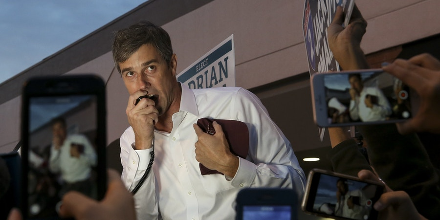 U.S. Senate candidate Beto O'Rourke talks to a group of supporters and early voters at the River Oaks Plaza parking lot Monday, Oct. 22, 2018, in Houston. (Godofredo A. Vasquez/Houston Chronicle via AP)