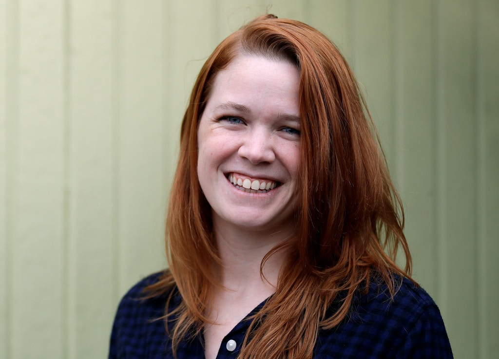 In this photo taken Friday, Oct. 26, 2018, House candidate Sarah Smith poses for a photo in Seattle. Smith thought her campaign to unseat longtime Rep. Adam Smith might receive a lot more attention after little-known Alexandria Ocasio-Cortez upset a 10-term incumbent in New York last summer. Like Ocasio-Cortez, Sarah Smith is a young woman, a political newcomer and a Bernie Sanders-supporting Democratic Socialist challenging an entrenched fellow Democrat. (AP Photo/Elaine Thompson)
