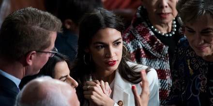 UNITED STATES - JANUARY 03: Rep. Alexandria Ocasio-Cortez, D-N.Y., is seen in the Capitol's House chamber before members were sworn in on the first day of the 116th Congress on January 3, 2019. (Photo By Tom Williams/CQ Roll Call) (CQ Roll Call via AP Images)